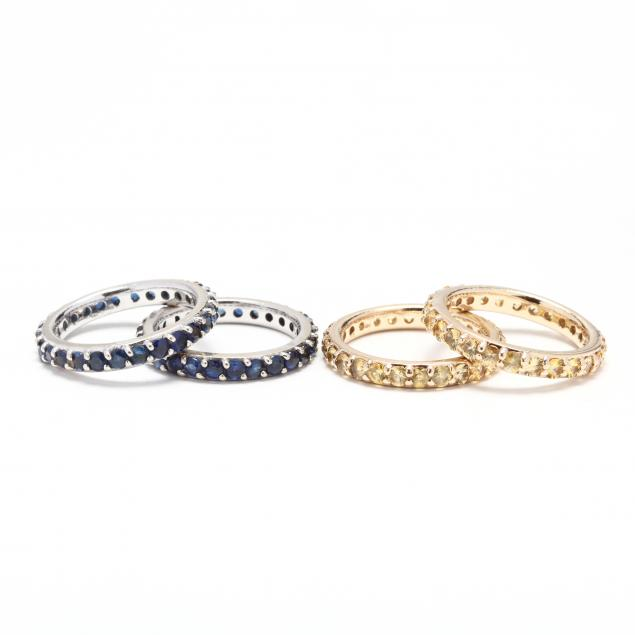 two-pairs-of-14kt-gold-and-sapphire-eternity-bands