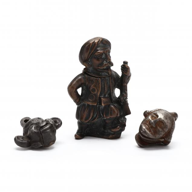 three-antique-small-metal-novelties