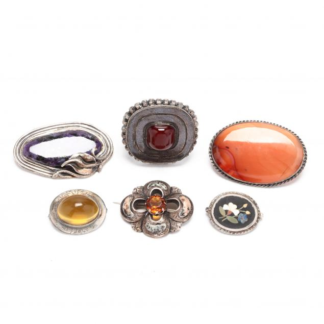 six-silver-and-gem-set-brooches