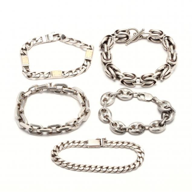 five-silver-link-bracelets