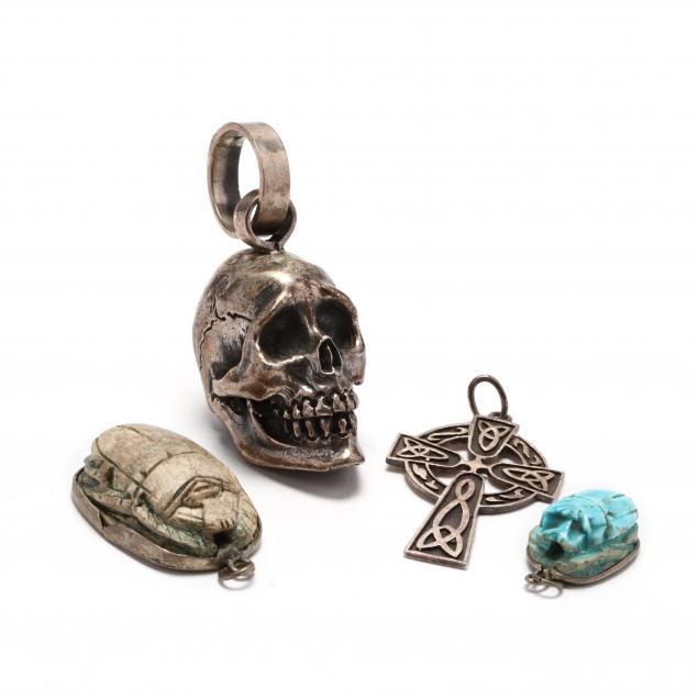 four-silver-pendants