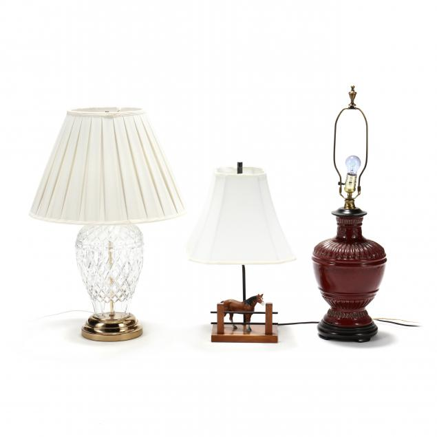 a-grouping-of-three-lamps