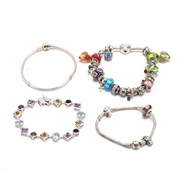 two-pandora-charm-bracelets-and-two-silver-bracelets