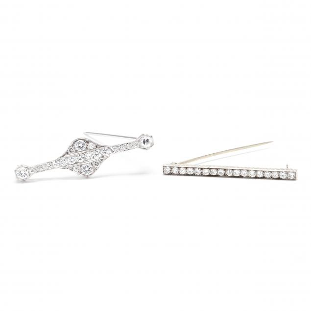 two-platinum-and-diamond-bar-brooches