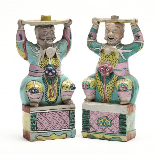 a-pair-of-chinese-figural-candle-holders