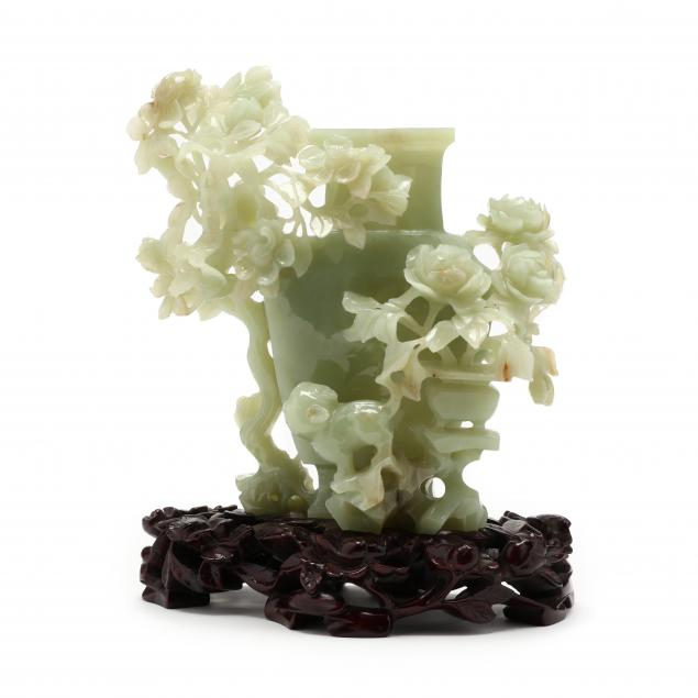 a-chinese-carved-hardstone-vase-on-stand