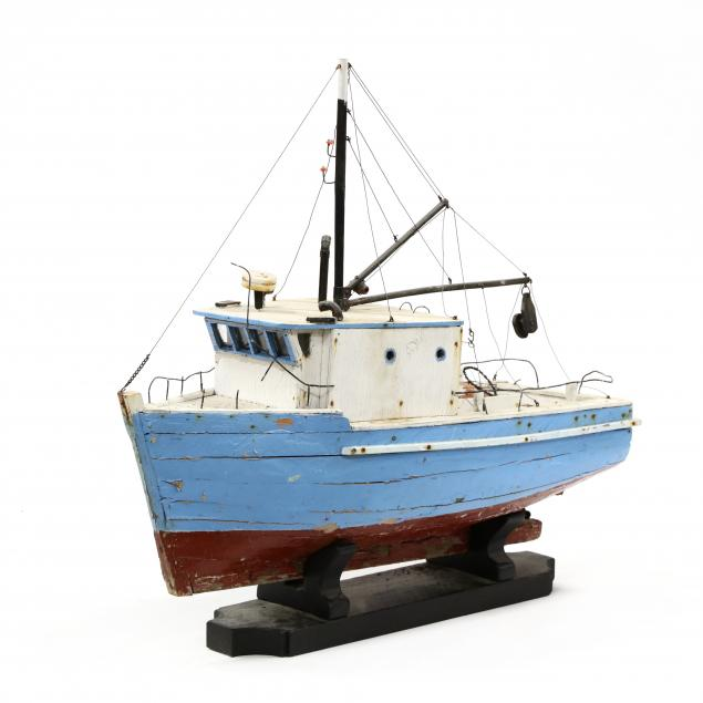 vintage-wooden-model-of-a-north-carolina-fishing-boat-on-stand