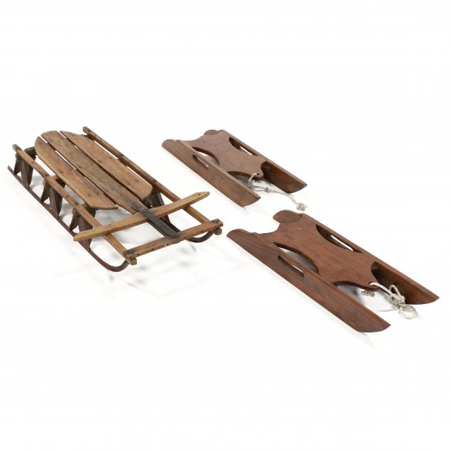 three-wooden-child-s-sleds