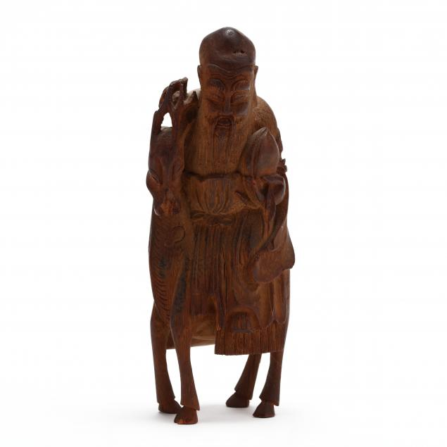 a-carved-wooden-figure-of-god-of-longevity