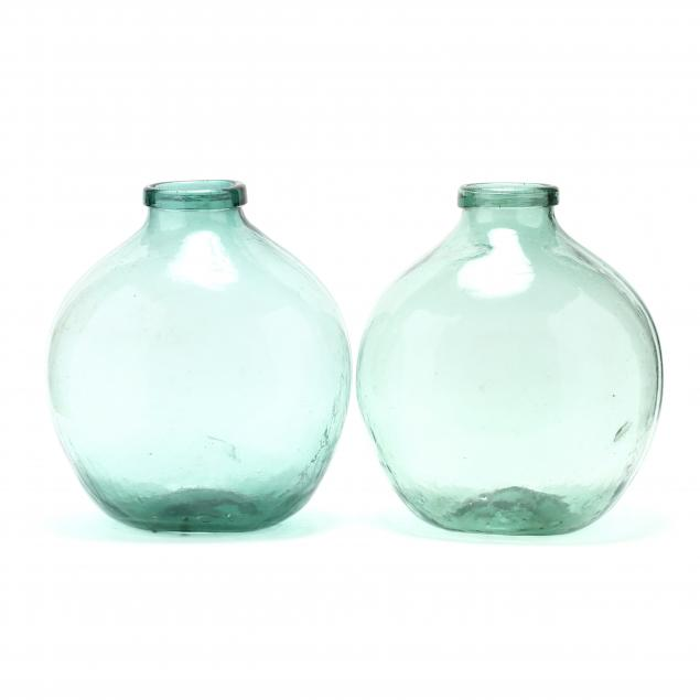 two-large-green-demijohn-bottles