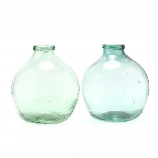 two-large-green-glass-demijohn-bottles