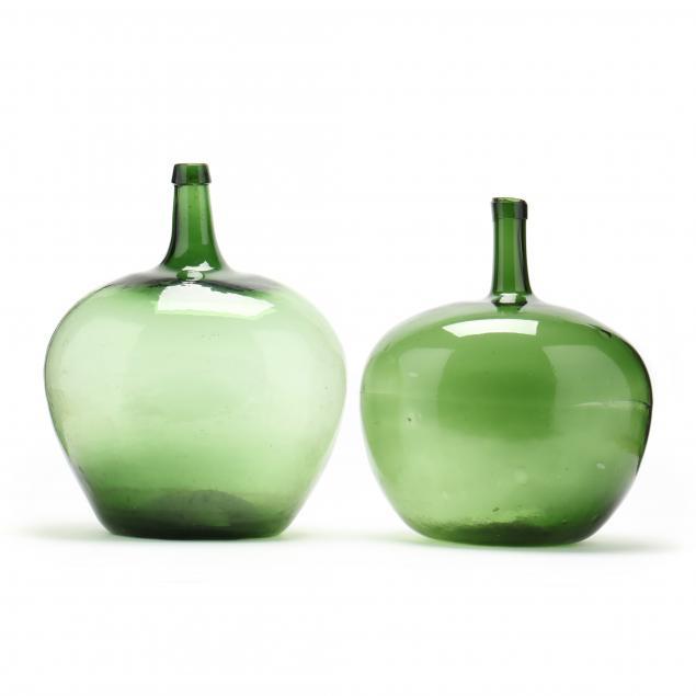 two-large-green-glass-demijohn-storage-bottles