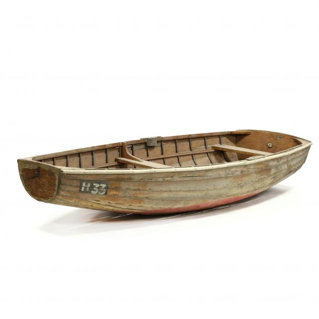 a-small-vintage-wood-dinghy-and-paddles-lucy