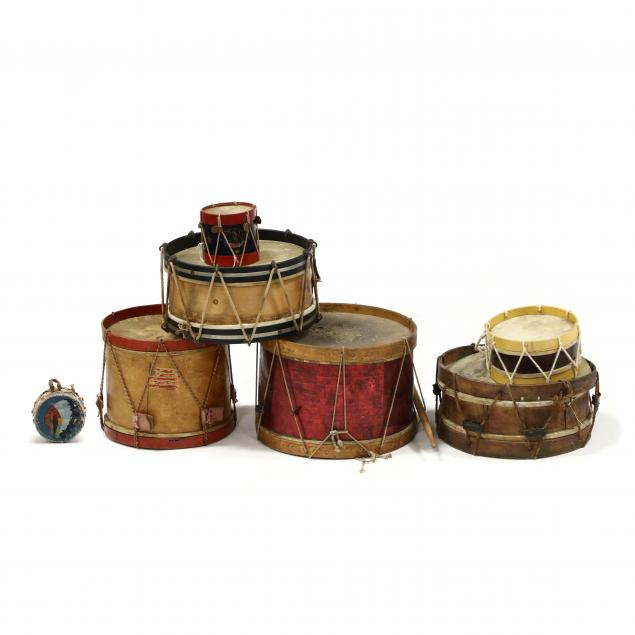 grouping-of-seven-small-drums