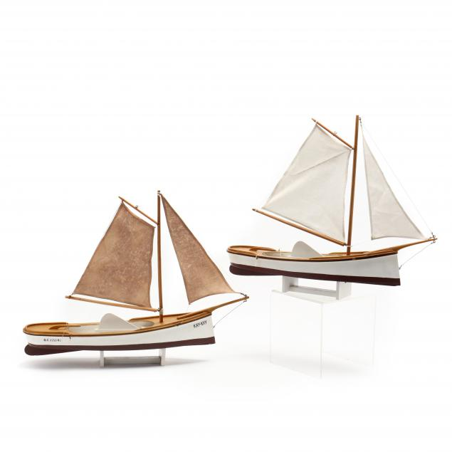 two-wooden-model-sailboats