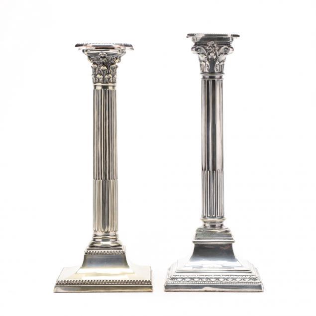 a-near-pair-of-english-corinthian-silverplate-candlesticks