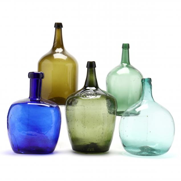 colorful-group-of-five-large-storage-bottles