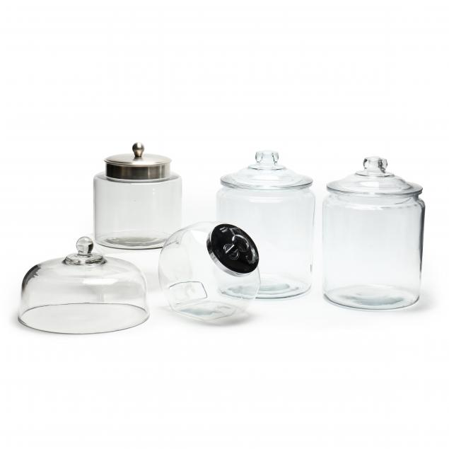 five-clear-glass-lidded-countertop-containers