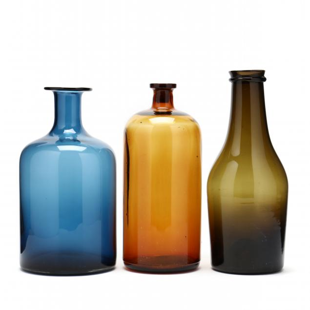 three-large-and-colorful-glass-bottles