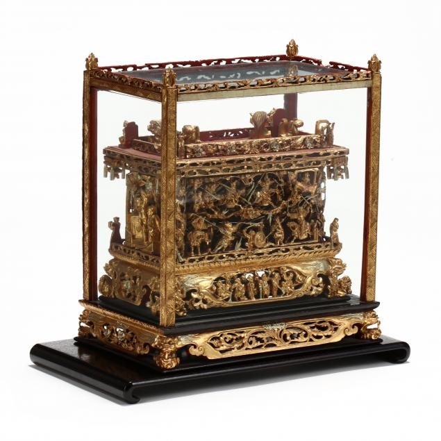 a-chinese-lacquered-and-gilt-coffer