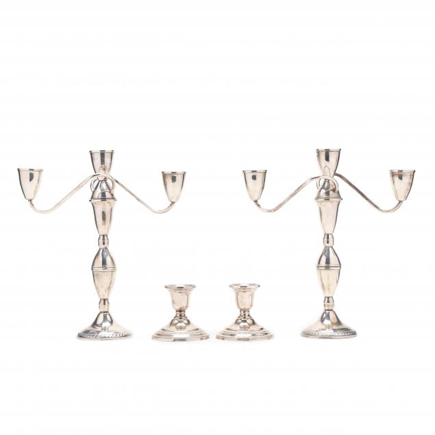 a-pair-of-sterling-silver-candelabra-and-a-pair-of-candlesticks
