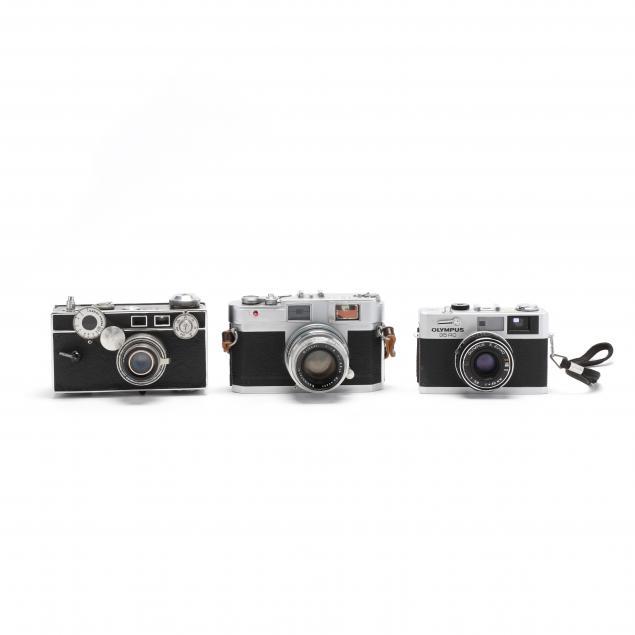 three-vintage-cameras