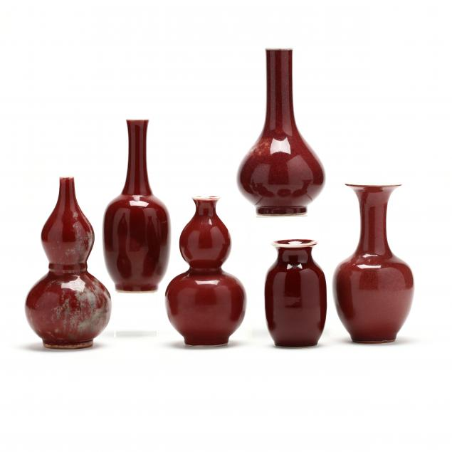 a-group-of-six-chinese-sang-de-boeuf-cabinet-vases