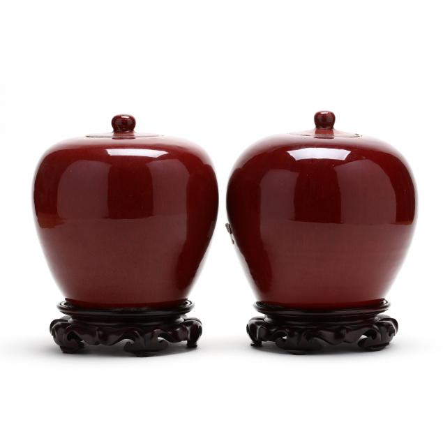 a-pair-of-chinese-sang-de-boeuf-lidded-jars
