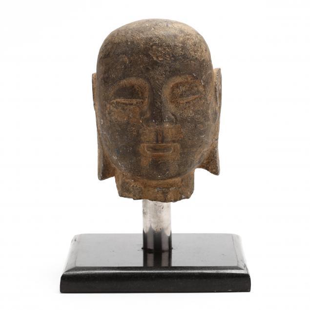 a-carved-stone-buddha-head
