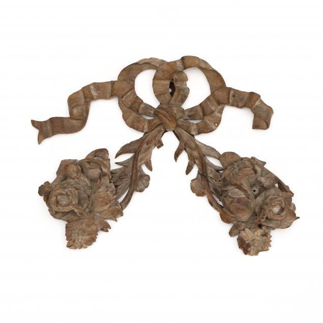 an-antique-carved-ribbon-and-floral-element