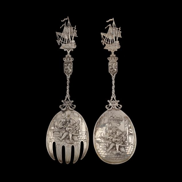 a-pair-of-figural-german-hanau-silver-serving-pieces