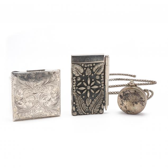 a-grouping-of-silver-and-silverplate-accessories