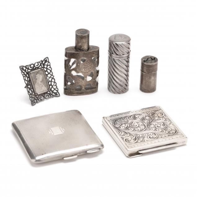 a-grouping-of-six-silver-vanity-accessories