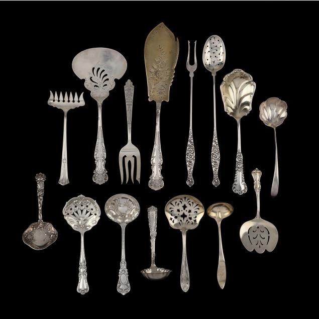 a-grouping-of-antique-sterling-silver-serving-flatware