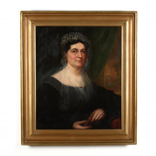 american-school-19th-century-portrait-of-a-woman-holding-the-new-testament