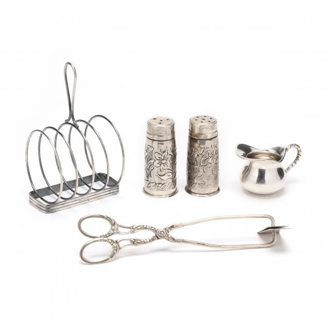 a-grouping-of-vintage-silver-dining-accessories