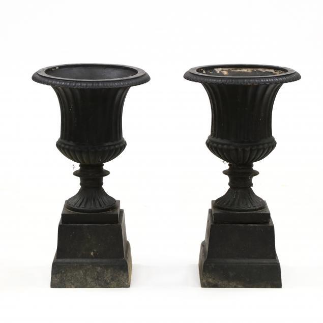 pair-of-cast-iron-garden-urns-on-stands