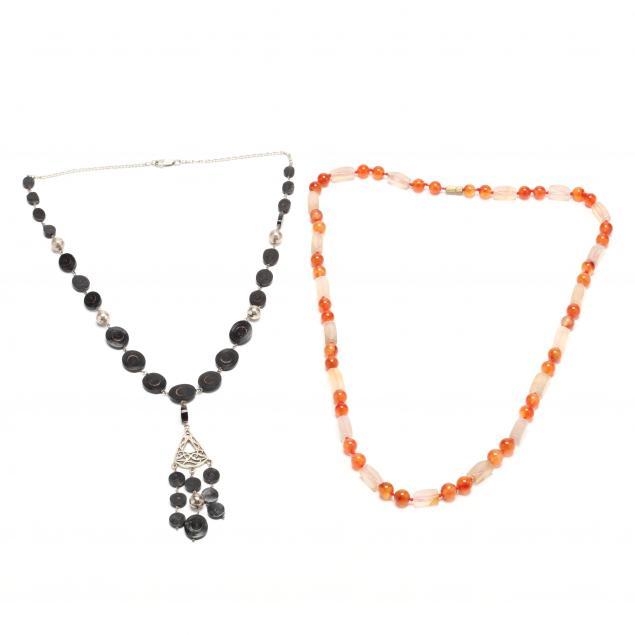 a-carnelian-and-chalcedony-necklace-and-a-silver-and-black-coral-necklace