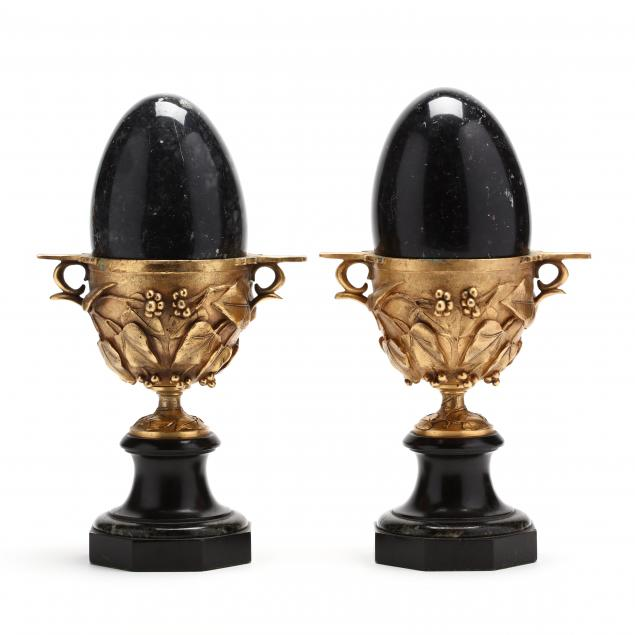 pair-of-black-marble-eggs-set-in-gilt-chalice-urns