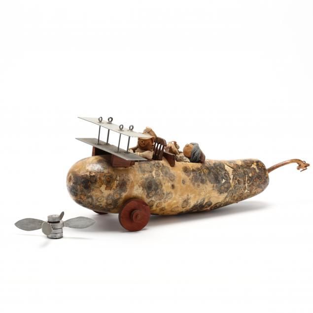 a-whimsical-contemporary-folk-art-gourd-biplane