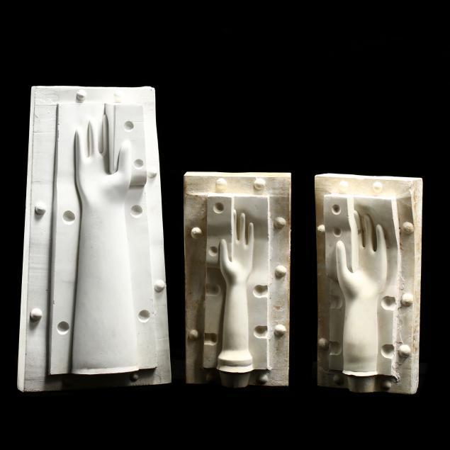 three-vintage-plaster-hand-molds