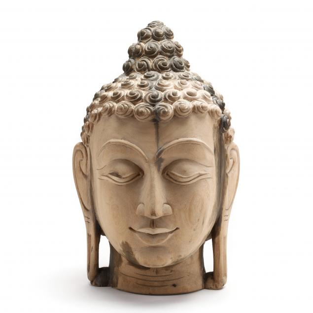 a-large-carved-wooden-buddha-head