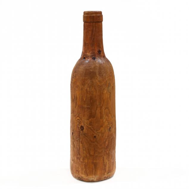 monumental-hand-carved-wooden-wine-bottle