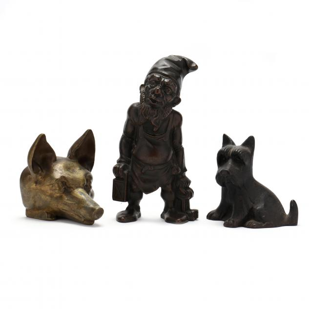 a-grouping-of-three-vintage-figural-door-stops