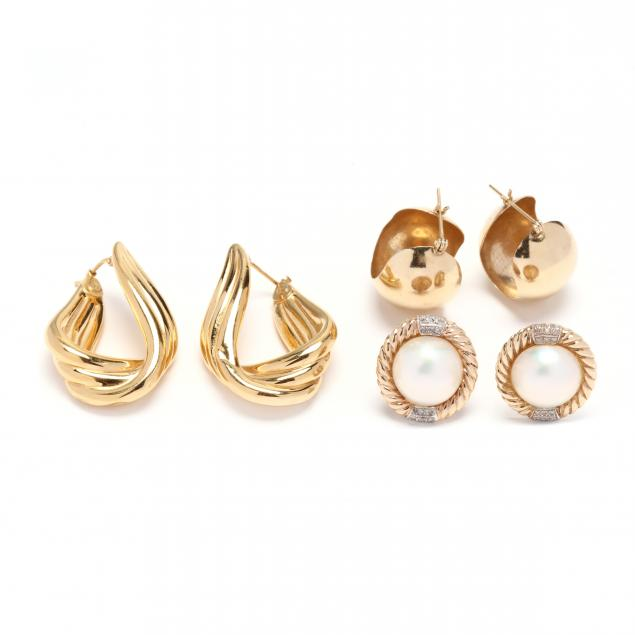 three-pairs-of-gold-earrings