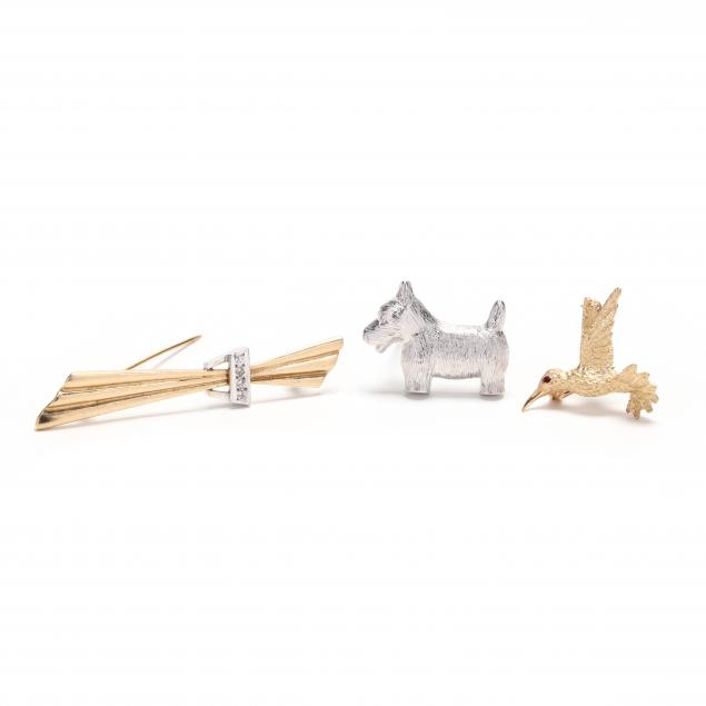 three-gold-brooches