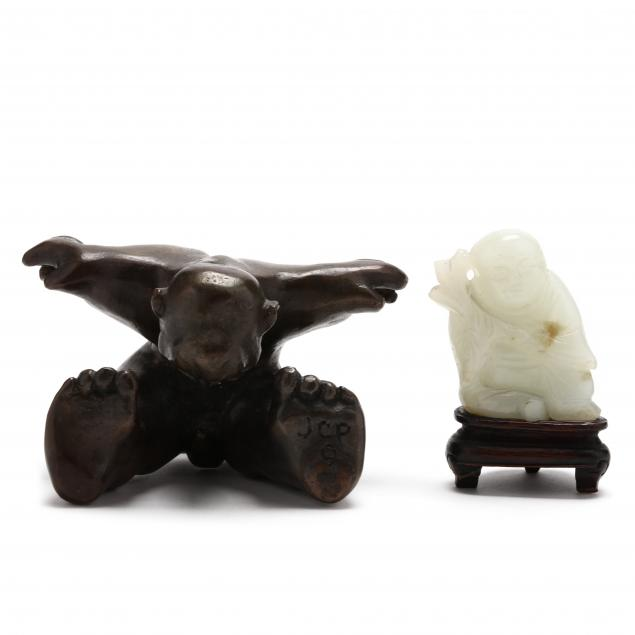 two-small-figural-sculptures