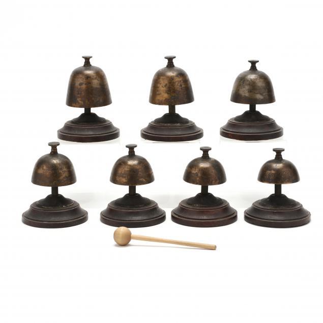 vintage-set-of-seven-mounted-asian-brass-bells