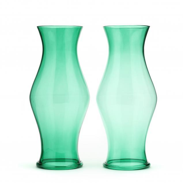 a-pair-of-green-glass-hurricane-shades