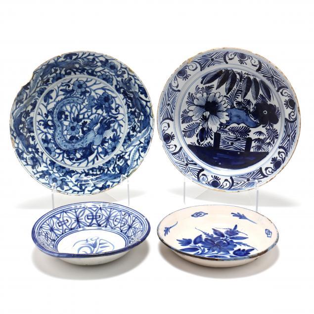 four-antique-dutch-delft-bowls-and-chargers